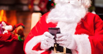 Santa Claus texting.